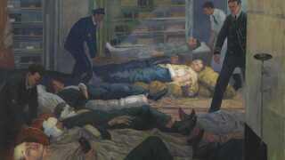 Sårede behandles under slaget i en kahyt under dæk på HMS Castor. Malet af Jan Gordon for Imperial War Museum, 1918.