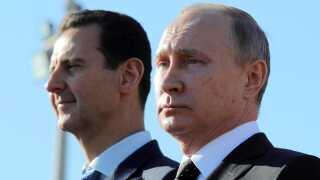 Den russiske præsident, Vladimir Putin (th), har støttet den syriske præsident, Bashar al-Assad.