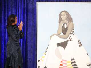 WASHINGTON, DC - FEBRUARY 12: Former U.S. first lady Michelle Obama looks at her newly unveiled portrait during a ceremony at the Smithsonian's National Portrait Gallery, on February 12, 2018 in Washington, DC. The portraits were commissioned by the Gallery, for Kehinde Wiley to create President Obama's portrait, and Amy Sherald that of Michelle Obama. Mark Wilson/Getty Images/AFP == FOR NEWSPAPERS, INTERNET, TELCOS & TELEVISION USE ONLY ==