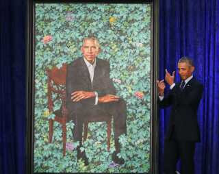 WASHINGTON, DC - FEBRUARY 12: Former U.S. President Barack Obama stands next to his newly unveiled portrait during a ceremony at the Smithsonian's National Portrait Gallery, on February 12, 2018 in Washington, DC. The portraits were commissioned by the Gallery, for Kehinde Wiley to create President Obama's portrait, and Amy Sherald that of Michelle Obama. Mark Wilson/Getty Images/AFP == FOR NEWSPAPERS, INTERNET, TELCOS & TELEVISION USE ONLY ==