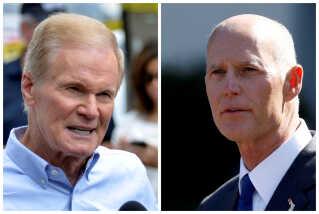 Demokraternes Bill Nelson (tv.) har ikke opgivet håbet om at blive senator i Florida endnu, selvom republikanernes Rick Scott har stået som sejrsherre i de første to optællinger.