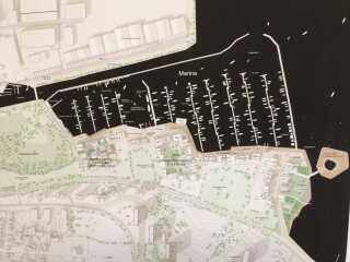 Skitse over Marina City med lystbådehavn, bolig og promenade.