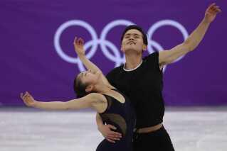 Ryom Tae-ok og Kim Ju Sik, det nordkoreanske kunstskøjteløb-par ved OL.