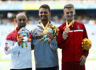 2016 Rio Paralympics - Men's Long Jump - T42 Final - Olympic Stadium - Rio de Janeiro, Brazil - 17/09/2016. Gold medalistHeinrich Popow of Germany poses with silver medalist Atsushi Yamamoto of Japan (L) and bronze medalist Daniel Wagner of Denmark (R) during the victory ceremony. REUTERS/Jason Cairnduff FOR EDITORIAL USE ONLY. NOT FOR SALE FOR MARKETING OR ADVERTISING CAMPAIGNS.