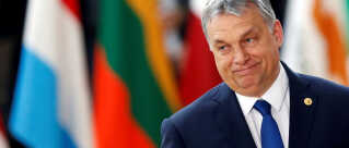 FILE PHOTO: Hungarian Prime Minister Viktor Orban arrives at the EU summit in Brussels, Belgium, March 9, 2017. To match Special Report HUNGARY-ORBAN/BALATON REUTERS/Francois Lenoir/File Photo
