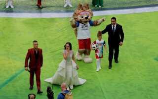 Robbie Williams, Aida Garifullina, den brasilianske fodboldverdenstjernen Ronaldo samt  VM-maskotten Zabivaka under åbningsceremonien, hvor mere end 500 gymnaster, dansere, trampolinspringere også stod for underholdningen forud for åbningskampen mellem værtslandet Rusland og Saudi Arabien.