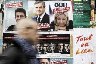 Jean-Luc Melenchon fra partiet 'La France Insoumise', Francois Fillon fra 'Les Republicains' og Front Nationals Marine Le Pen figurerer side om side på valgplakater i Paris.