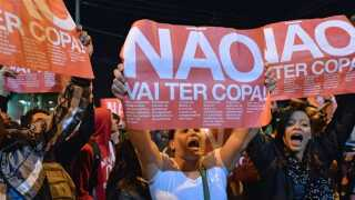 "Demonstrators shout slogans and hold signs reading ""You are not going to have cup"" during a protest protest against the upcoming FIFA World Cup Brazil 2014 in Sao Paulo, Brazil on April 29, 2014."