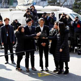 Sangeren Jung Joon-young ankommer til sin afhøring hos Seoul Metropolitan Police Agency i Sydkoreas hovedstad, Seoul, torsdag 14. marts.