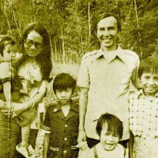 Minh Les forældre og søskende, efter de er ankommet til Canada.