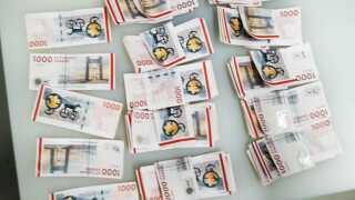 Et foto fra optællingen af nogle af de penge, der blev fundet under efterforskningen af sagen. Foto: Politiet