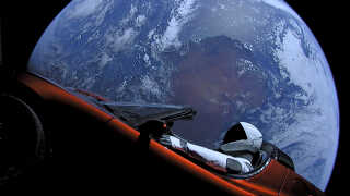 A cherry red Tesla Roadster automobile floats through space after it was carried there by SpaceX's Falcon Heavy in this image obtained by Reuters on February 9, 2018. SpaceX/Handout via REUTERS. ATTENTION EDITORS - THIS IMAGE WAS PROVIDED BY A THIRD PARTY.NO SALES.NO ARCHIVE.