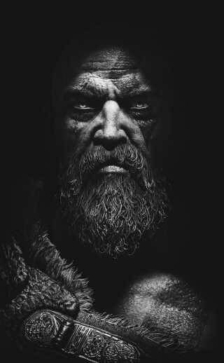 I 2016 trådte God of War-hovedpersonen Kratos ud af skyggerne for første gang på E3-spilmessen. Det gav en helt vild fed reaktion fra alle God of War-fans. Den følelse har jeg prøvet at fange med dette portrætbillede, siger Rasmus Furbo. (Spil: God of War)