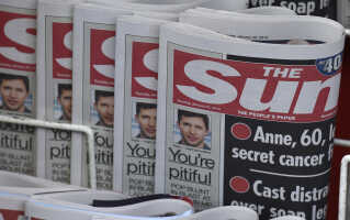 I 2015 droppede den britiske avis The Sun at bringe billeder af topløse kvinder på side 3. Arkivfoto.
