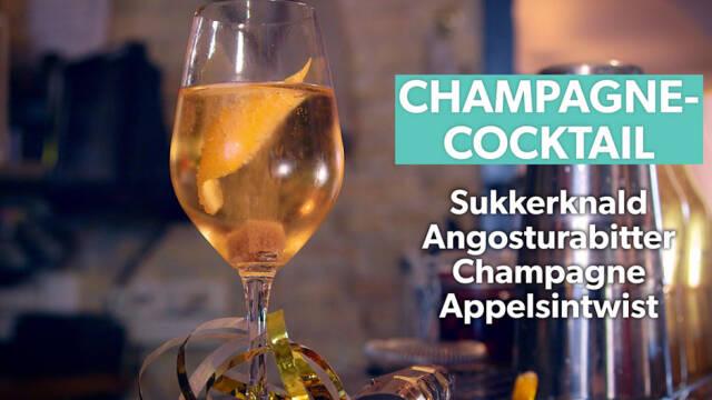 Lys cocktail med appelsinskal i champagneglas