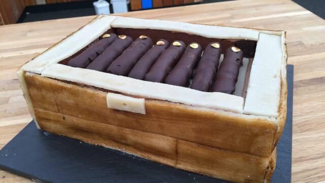 Billede af en flot og spiselig cigarkasse med lækre og søde cigarer.